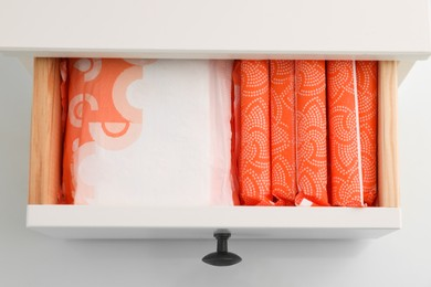 Storage of different feminine hygiene products in drawer, top view