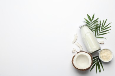 Delicious vegan milk and coconut on white background, flat lay. Space for text