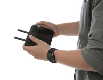 Man holding new modern drone controller on white background, closeup of hands