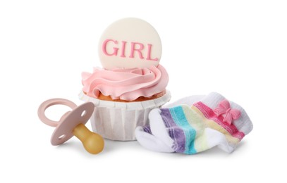 Baby shower cupcake with Girl topper near pacifier and socks on white background