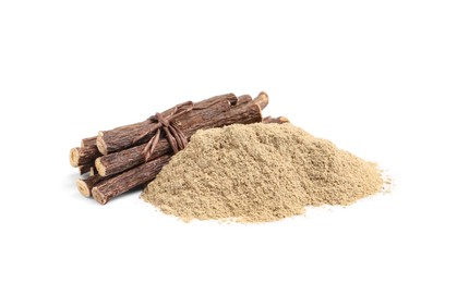 Dried sticks of liquorice root and powder on white background