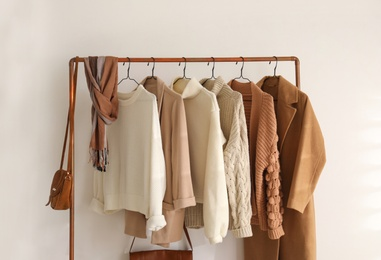 Rack with stylish women's clothes indoors. Modern interior design