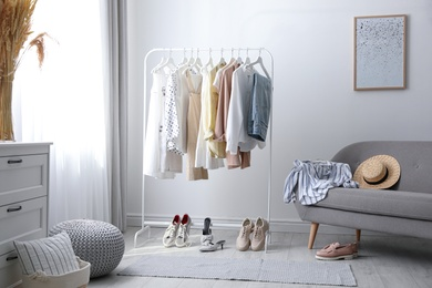 Dressing room interior with clothing rack and sofa