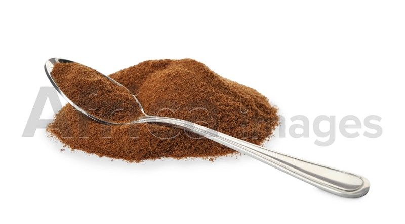 Spoon and chicory powder on white background