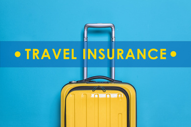 Yellow suitcase and phrase TRAVEL INSURANCE on blue background