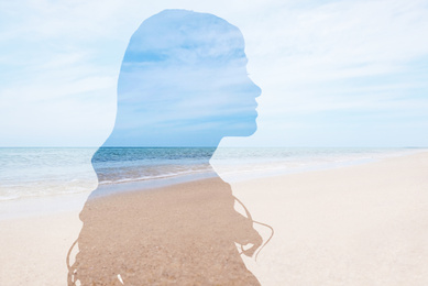 Double exposure with silhouette of woman and sea landscape. Concept of psychological health