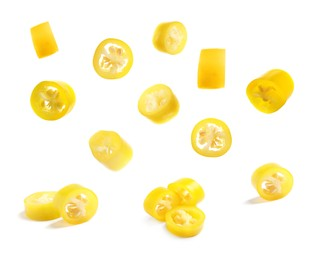 Pieces of yellow chili peppers on white background