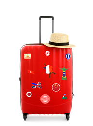 Red suitcase with travel stickers on white background
