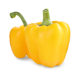 Ripe yellow bell peppers isolated on white