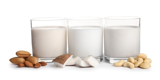 Vegan milk and different nuts on white background