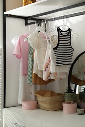 Closet interior with storage rack for clothes and accessories