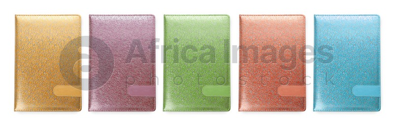 Set with different multicolored planners on white background, top view. Banner design