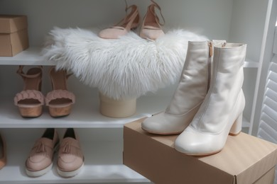 Different stylish women's shoes in dressing room