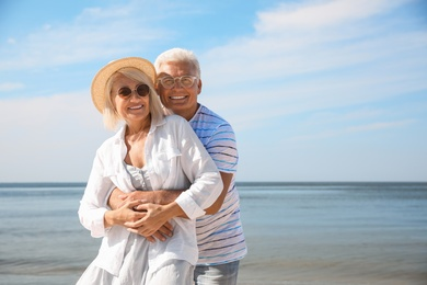 Mature couple spending time together on sea beach