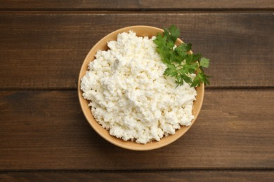 Delicious fresh cottage cheese on wooden table, top view