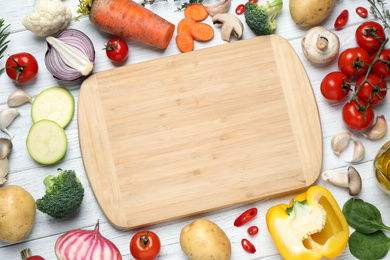 Flat lay composition with fresh products on white wooden table, space for text. Healthy cooking