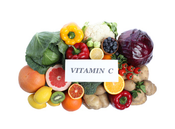 Paper note with phrase VITAMIN C and fresh products on white background, top view