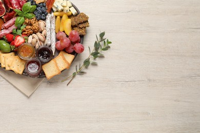 Different tasty appetizers on wooden table, flat lay. Space for text