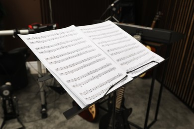 Note stand with music sheets at recording studio. Band practice