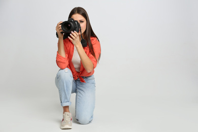 Professional photographer working on white background in studio