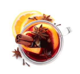 Aromatic mulled wine and ingredients on white background, top view