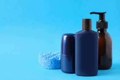 Set of different men's cosmetic products on light blue background. Space for text