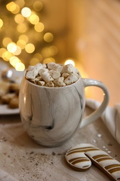 Tasty hot drink with marshmallows on table. Christmas atmosphere