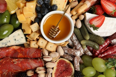 Set of different delicious appetizers as background, top view