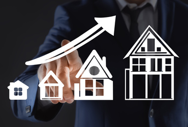 Real estate agent demonstrating prices at housing market. Man pointing on graph illustration, closeup