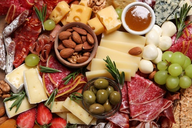 Tasty assorted appetizers as background, top view