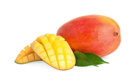 Whole and cut juicy mangoes isolated on white