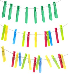 Colorful plastic clothespins hanging on ropes against white background
