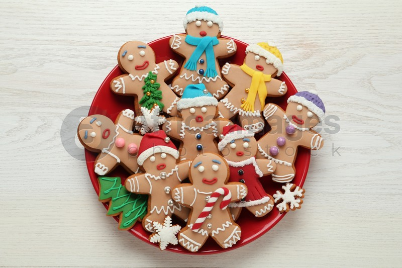 Delicious Christmas cookies on white wooden table, top view