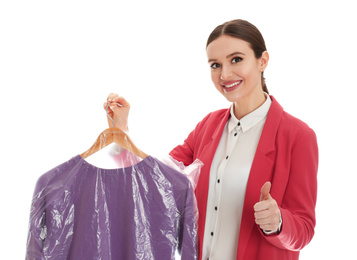 Young woman holding hanger with sweatshirt on white background. Dry-cleaning service