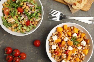 Delicious fresh chickpea salads on grey table, flat lay