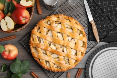 Delicious traditional apple pie on wooden table, flat lay