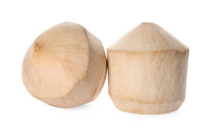 Fresh young peeled coconuts on white background