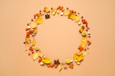 Flat lay composition with autumn leaves on beige background, space for text