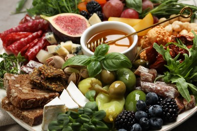Set of different delicious appetizers on plate, closeup