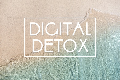 Text Digital Detox and top view of ocean waves rolling on sandy beach as background