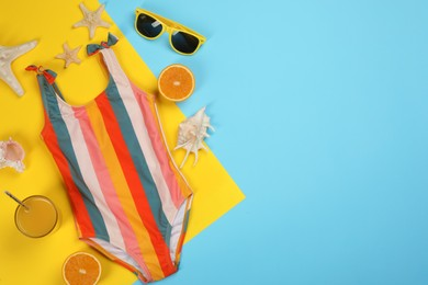 Flat lay composition with beach objects on color background, space for text