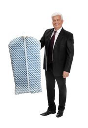 Senior man holding garment cover with clothes on white background. Dry-cleaning service