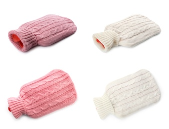 Set of hot water bottles with knitted covers on white background