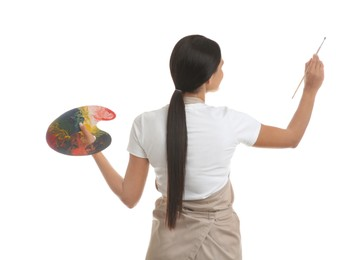 Young woman drawing with brush on white background, back view