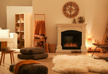 Beautiful view of cozy living room interior with fireplace