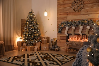 Stylish room interior with beautiful Christmas tree and decorative fireplace