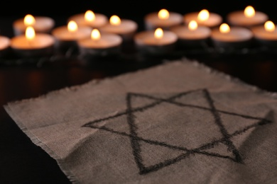 Fabric with star of David on black background. Holocaust memory day