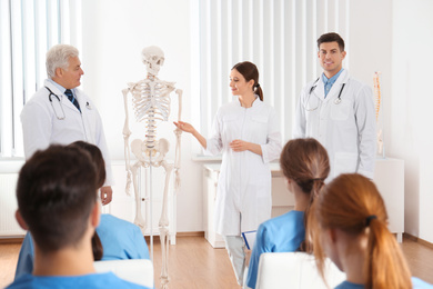 Medical students having lecture in orthopedics at clinic