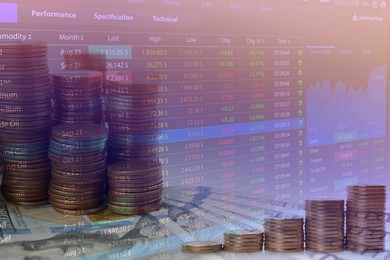 Double exposure of electronic trading platform and stacked coins. Stock exchange