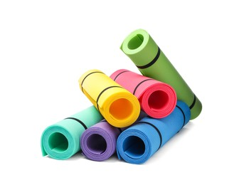 Colorful rolled camping or exercise mats on white background